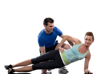 couple on Abdominals workout posture on white background