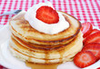 Stack of delicious pancakes with strawberries