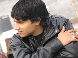 portrait of a young indian man wearing leather jacket