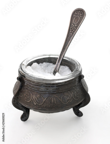antiques silver saltcellar with silver spoon  on white