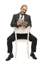 sit businessman and money