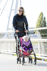 woman with toddler sitting in pram on walk