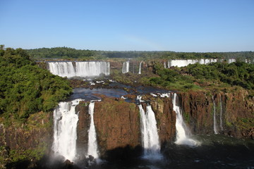 Iguassu waterfalls on a sunny day early in the morning.