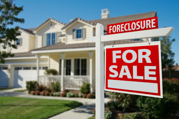 Foreclosure Real Estate Sign and House