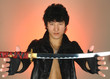 asian man with katana sword