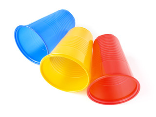 three colorful plastic cups