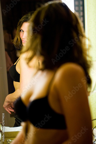 sexy woman looking in the mirror - 21679838