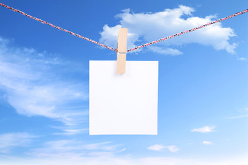 white paper  on blue sky background
