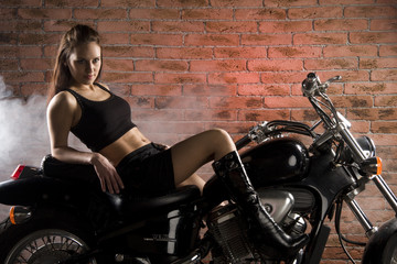 young woman in a motorbike