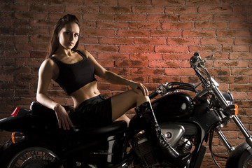 young women on a motorbike