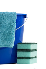 Cleaning cloth a blue bucket and 3 scrubbers