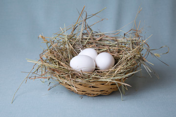 three eggs lies in basket