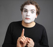 portrait of the mime isolated on grey background