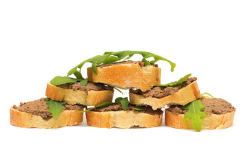 Antipasto. Pate, arugula and baguette slices isolated on white b