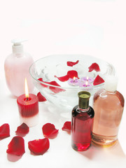 spa bowl with rose petals and essences vials
