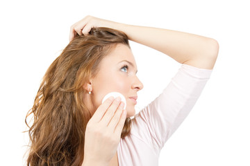 brunette removing facial makeup