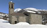 Romanesque church in mountain winter landscape poster