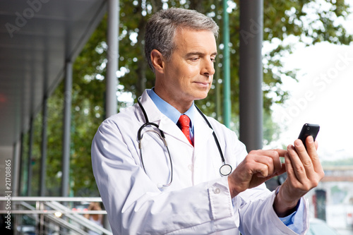 Doctor with a mobile phone