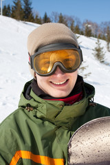 Smiling guy with snowboard