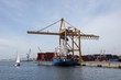 Container merchant ship and crane