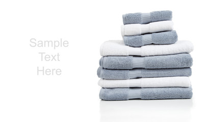 Gray and white towels on white with copy space