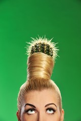 Woman with cactus in her hair .