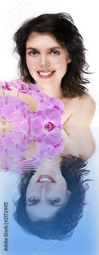girl in bath with orchid flower