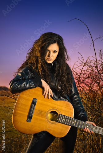 young artistic woman at spring sunset