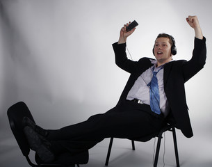 Happy businessman enjoying music