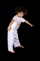 Small girl making capoeira moves