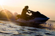 canvas print picture - beautiful girl riding her jet skis