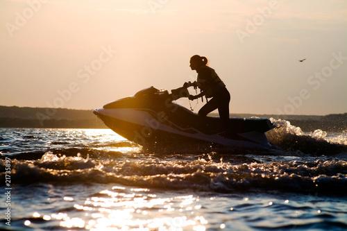 beautiful girl riding her jet skis - 21735897