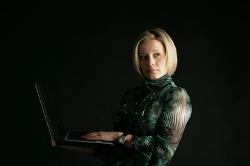 Portrait of the girl-blonde with a laptop in hands