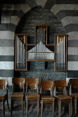 Old organ pipes and chairs