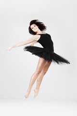 Stylish and young ballet style dancer is jumping