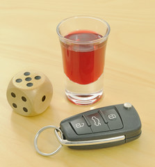 Drink, car keys and dice symbolising the risks of drink-driving