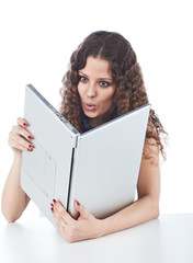 Beautiful young woman holding a laptop in improper way