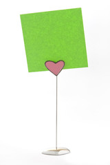 Green notes on heart shape holder
