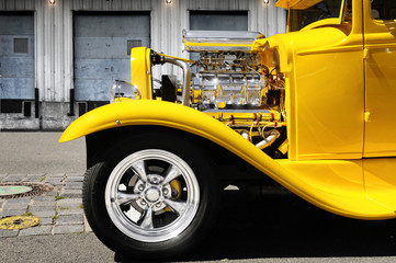 front partof a classic yellow hot rod