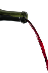 Red wine pouring out of bottle