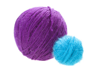 white and yellow balls of yarn on a white background