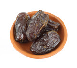 Medjool dates in a small dish