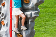 Young Girl on Rock Wall at the Park