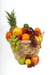 fruit basket overflowing onto white background
