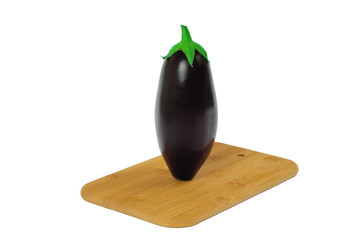 Eggplant on wooden board isolated on white.