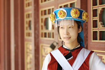 Chinese woman in traditional clothes of the Naxi minority
