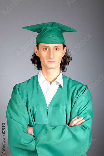 portrait of a succesful man on his graduation day in green