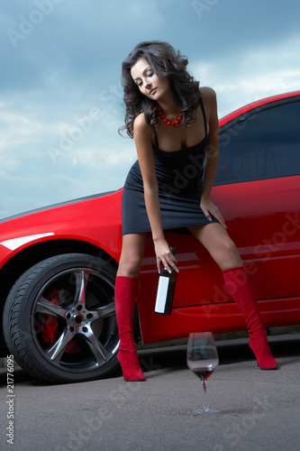 woman with  wine glass  in the car