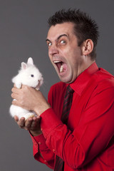 Funny man with white baby rabbit