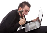 Frustrated businessman destroying his PC with a hammer